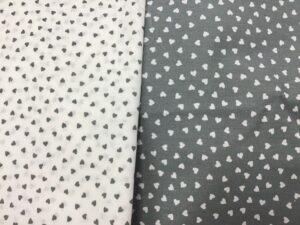 Corazones gris y blanco